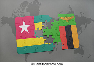 puzzle with the national flag of togo and zambia on a world...