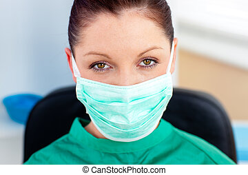 Portrait of a confident surgeon in her office looking at the...
