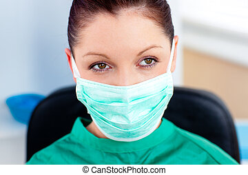 Portrait of a serious surgeon with mask in a hospital