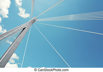 fragment of a cable stayed bridge on the sky background