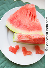 close-up on the table are two pieces of watermelon