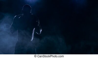 Strong blows boxer. Workout before the fight. Silhouette...