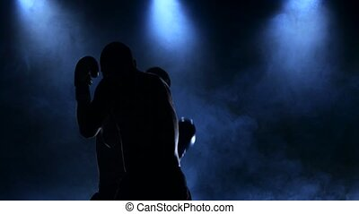 Duel of two boxers in the studio. Silhouette of smoke - Duel...