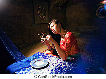 young pretty asian girl in bright colored interior on carpet...