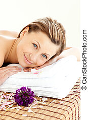relaxed woman lying on a massage