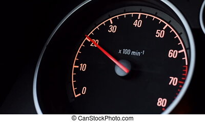 Car tachometer and moving pointer on it.