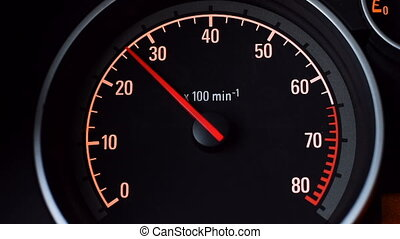 Car tachometer and moving pointer on it. Load on the engine