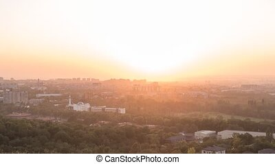 Sunset over the city of Alma Ata. Kazakhstan. Zoom. Time...