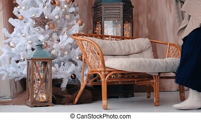 Young woman siting on sofa in the living room before christmas