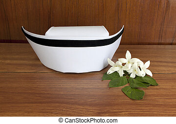 Hat nurse white and Millingtonia hortensis flowers on wood...