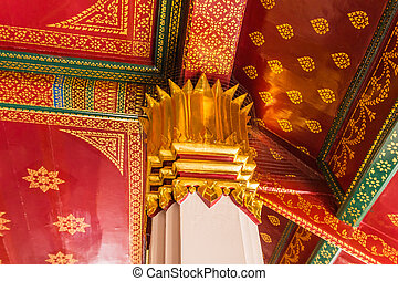 Columns decorated with gold plated ornament in Buddhist Thai...