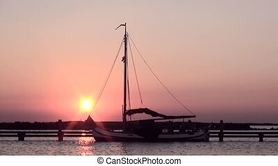 Classic Dutch sailboat in the sunset on IJsselmeer. - Sunset...