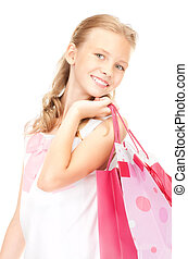 little shopper - happy girl with shopping bags over white