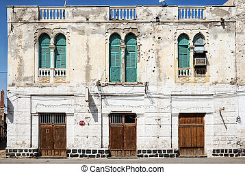 local architecture street in central massawa old town...