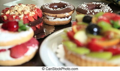 Delicious tart with fresh fruits cakes and donuts - Assorted...