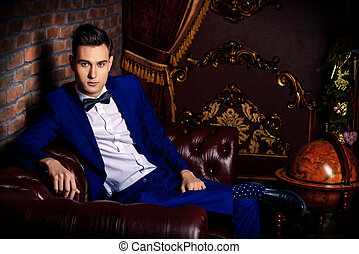 classy apartments - Imposing well dressed man in a luxurious...