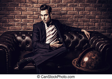 rich life - Imposing well dressed man in a luxurious...