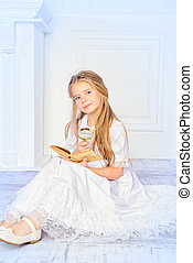 christmas fairytales - Angelic little girl with blonde hair...