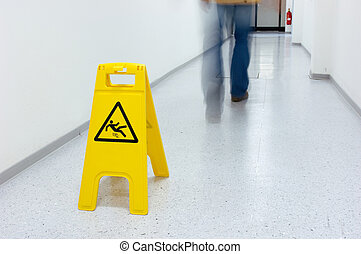 Slippery floor - Warning sign for slippery floor in a...