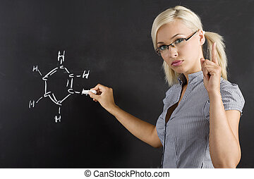 teacher at lesson - very pretty and young teacher in act to...