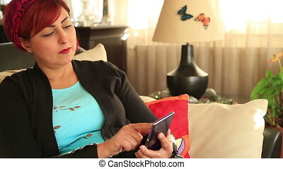Attractive middle aged woman using smart phone