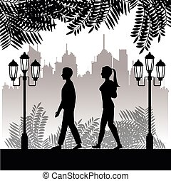 silhouette guy and girl walk park twon background