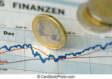 Finance Chart - Euro coins rolling over a finance chart