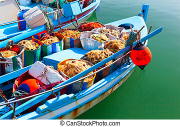 Fishing boats with fishing gear.