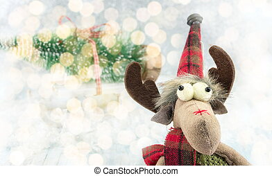 Reindeer toy and Christmas lights background