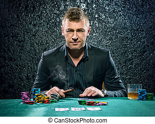 gambling business - Rich gambler man with the cards and...