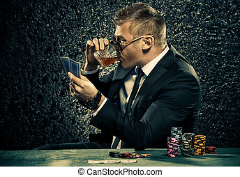 drinking brandy - A wealthy mature man drinking brandy and...