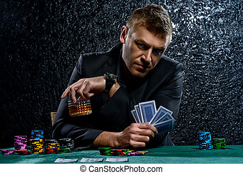 poker game - A wealthy mature man drinking brandy and...