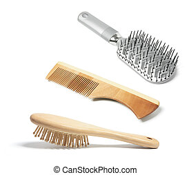 Hairbrushes and Comb on White Background