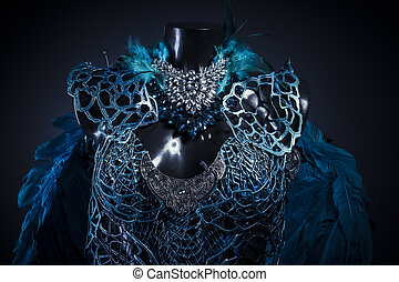 Imagination, Handmade styling of a bird or mythological figure with blue wings and pieces of metal and precious stones