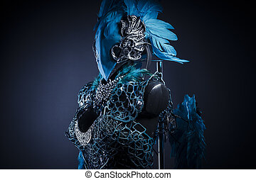 Fantasy, Handmade styling of a bird or mythological figure with blue wings and pieces of metal and precious stones
