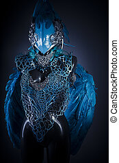 Cosplay, Handmade styling of a bird or mythological figure with blue wings and pieces of metal and precious stones