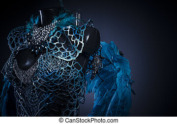 Fallen angel, Handmade styling of a bird or mythological figure with blue wings and pieces of metal and precious stones