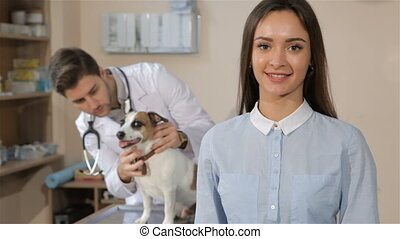Woman gestures good quality at the veterinarian clinic....