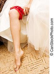 Red wedding garter - Red crush wedding garter at the leg of...
