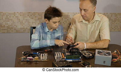 Dad teaches his son a teenager, what's inside the computer