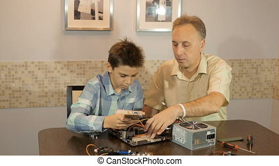 Dad teaches his son a teenager, what's inside the computer,...