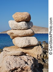 Emborio stones, Halki - A tower of stones on Ftenagia beach...