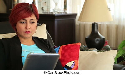 Woman receiving bad news - Red hair woman with digital...