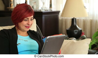 Woman having a video conference with digital tablet computer