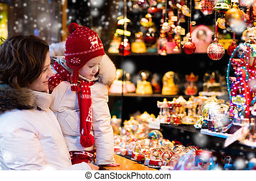 Mother and child on Christmas market - Mother and little...