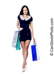 Portrait of happy smiling woman hold shopping bag. Female isolated over white background