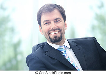Happy mature business man looking at camera with...
