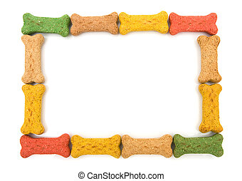 Dog border - Dog treats making a border isolated on a white...