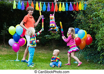 Kids playing with birthday pinata - Kids birthday party....