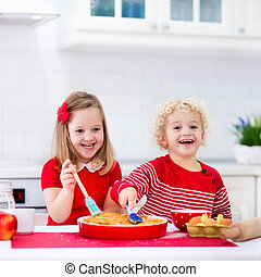 Kids baking apple pie